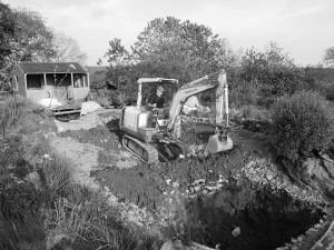 Paul digging the koi pool
